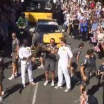 Torch Relay passes the Coach and Horses